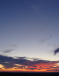 Sunset highlights crescent moon and Venus