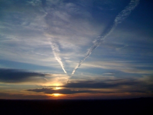 "Contrails form a ""v"" with the point toward earth"
