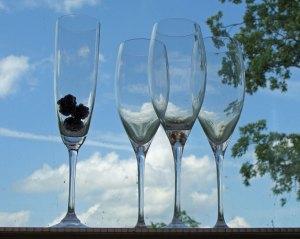 Blackberries in champagne flute.