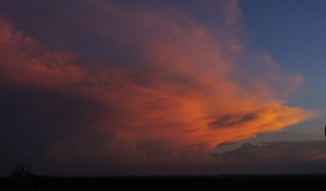 Windswept thunderhead catches setting sun