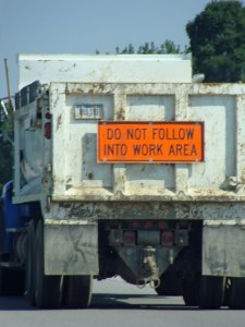 Dump truck with sign