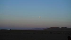 Moon rises over Chinese desert.