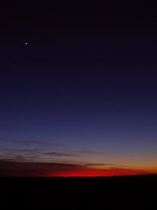 Jan. 7 sunset with crescent moon.