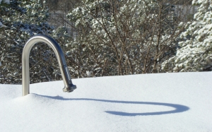 Outdoor faucet and its shadow.