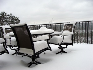 Deck chairs filled with snow