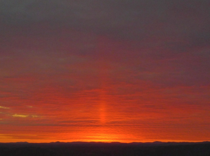Feb. 17, 2013, jet of light at sunset.