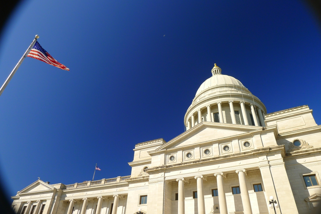 Arkansas State Capitol under a cloudless October sky.
