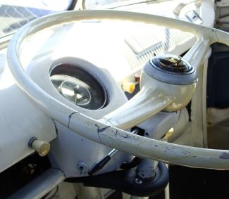 TAKE THE WHEEL -- Steering wheel a little worse for wear in a '66 VW bus.