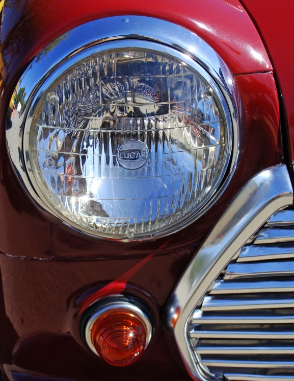 LIGHT THE WAY -- Headlight and part of the grille of a restore Austin Mini -- complete with 10-inch wheels.
