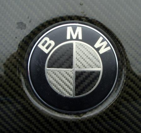 Carbon fiber badge on a 3-series with a carbon fiber bonnet.