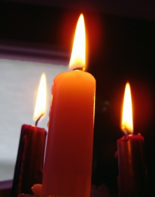 The rose candle is lit for the third day of Advent.