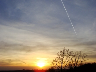 Sunset with contrail.