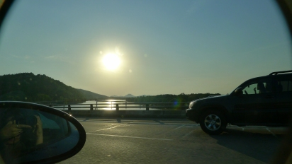 Afternoon sun over the I-430 bridge over the Arkansas River with Pinnacle Mountain in the background.