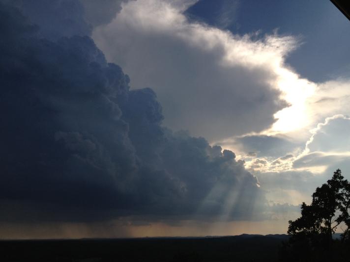 Clouds, sun rays, rain