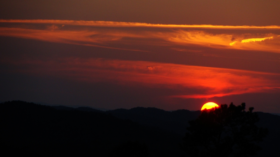 iery sunset in the Ouachitas.